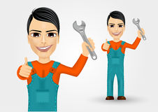 Young plumber dressed in work clothes Royalty Free Stock Photo
