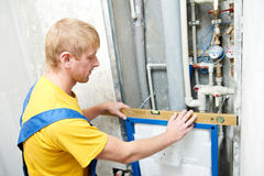 Young plumber man worker stock photography