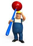 Young Plumber with toilet plunger Royalty Free Stock Photo