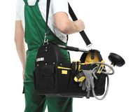 Young plumber with tool bag. On white background, closeup royalty free stock photo