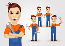 Young plumbers dressed in work clothes Royalty Free Stock Photo
