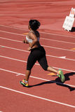 Young plump black woman running on track Royalty Free Stock Photography