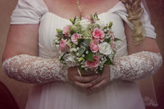 Young plump bride. Holding a bouquet close-up Stock Photography