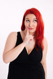 Young plump red-haired woman Royalty Free Stock Photography