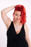 Young plump red-haired woman Royalty Free Stock Photo
