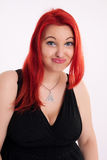 Young plump red-haired woman Stock Image