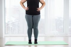 Young plus size woman before home workout stock images