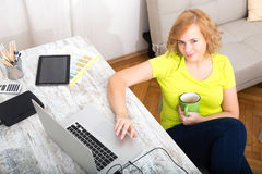 Young plus size woman working on a  laptop computer Stock Photos