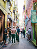 Young people gather in Neals Yard, London. London, England, August 23, 2015: Young people cluster and chat in Neals Yard, in London royalty free stock photo