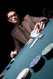 Young poker player. Handsome young adult man playing poker game Royalty Free Stock Photo