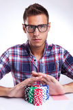 Young poker player with eyeglasses going all in Royalty Free Stock Image