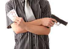 Young poker player with gun Stock Photo