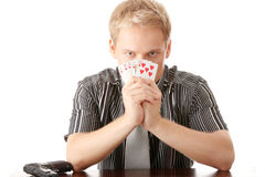 Young poker player with gun Stock Images