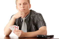 Young poker player with gun Stock Photos