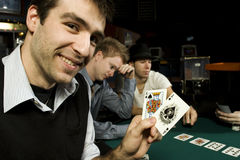 Young poker player holding winning hand Royalty Free Stock Image