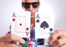 Young poker player showing a pair of aces Stock Photography