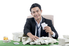 The young poker player winning and holding set of aces stock photo