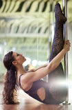 Young pole dance woman. On warm-up. Shallow dof effect Stock Photos