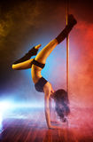 Young pole dance woman Royalty Free Stock Image