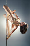 Young pole dance woman Royalty Free Stock Photography