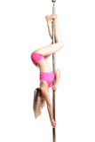 Young pole dance woman make basic invert isolated Royalty Free Stock Image