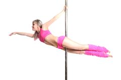 Young pole dance woman make superman isolated Stock Photos