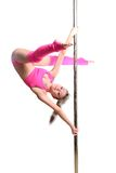 Young pole dance woman make twisted grip handspring isolated Royalty Free Stock Image