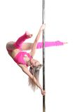 Young pole dance woman make twisted grip handspring isolated Stock Images