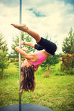 Young pole dance woman Stock Photo