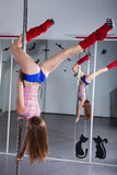 Young pole dancer Royalty Free Stock Photos