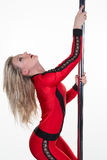 Young pole dancer woman wearing red sports wear Royalty Free Stock Photos
