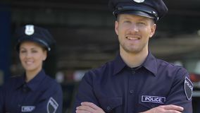 Young police man and woman smiling, happy to serve for city security, recruits. Stock footage stock video footage