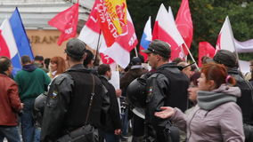 Young police officers along protesters, Russia stock video footage