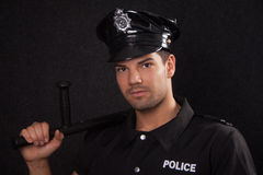 Young policeman with blackjack. Young handsome policeman with blackjack Stock Photography