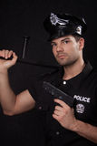 Young policeman with guns. Young handsome policeman with guns stock photo