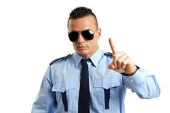 Young policeman shows on you. Young strict man in police uniform shows with finger on you royalty free stock images