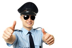 Young policeman. Shows you two fingers up, right you can write some text royalty free stock images