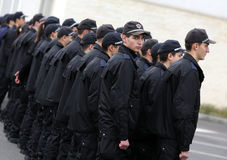 Young policemen in formation Royalty Free Stock Photos