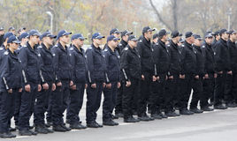 Young policemen in formation Royalty Free Stock Photo