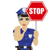 Young policewoman holding stop sign and showing stop gesture Stock Images