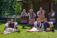 Young Polish dancers in traditional costume perform in one show Royalty Free Stock Images