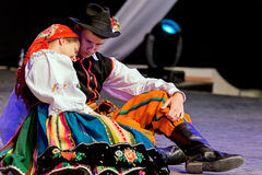 Young Polish dancers in traditional costume, perform in a show Royalty Free Stock Image