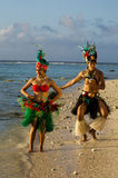 Young Polynesian Pacific Island Tahitian Dancers Couple. Portrait of attractive young Polynesian Pacific Island Tahitian male and female dancers in colorful Royalty Free Stock Photo