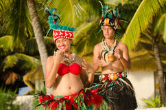 Young Polynesian Pacific Island Tahitian Dancers Couple. Portrait of attractive young Polynesian Pacific Island Tahitian male and female dancers in colorful Stock Photo