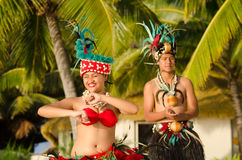 Young Polynesian Pacific Island Tahitian Dancers Couple. Portrait of attractive young Polynesian Pacific Island Tahitian male and female dancers in colorful Royalty Free Stock Photos