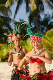 Young Polynesian Pacific Island Tahitian Dancers Couple. Portrait of attractive young Polynesian Pacific Island Tahitian male and female dancers in colorful Stock Photography