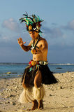 Young Polynesian Pacific Island Tahitian Man Dancer. Portrait of attractive young Polynesian Pacific Island Tahitian male dancer in colorful costume dancing on Royalty Free Stock Photos