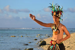 Young Polynesian Pacific Island Tahitian Man Dancer. Portrait of attractive young Polynesian Pacific Island Tahitian male dancer in colorful costume dancing on Royalty Free Stock Image