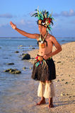 Young Polynesian Pacific Island Tahitian Man Dancer. Portrait of attractive young Polynesian Pacific Island Tahitian male dancer in colorful costume dancing on Stock Image