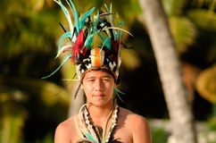 Young Polynesian Pacific Island Tahitian Man Dancer. Portrait of attractive young Polynesian Pacific Island Tahitian male dancer in colorful costume dancing on Royalty Free Stock Photo